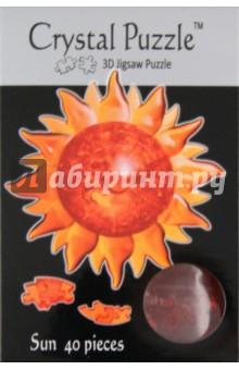 Головоломка СОЛНЦЕ (90115)Головоломки<br>Трехмерная 3D головоломка СОЛНЦЕ от CRYSTAL PUZZLE. Головоломка состоит из 40 деталей, собрав которые вы получите красивый сувенир Солнце.<br>Инструкция внутри.<br>Сделано из пластика.<br>Рекомендуемый возраст: от 14 лет.<br>Упаковка: блистер.<br>Сделано в Китае.<br>