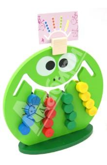 Логическая игра Лягушка (ЛИ-01)Другие настольные игры<br>Увлекательная обучающая игра-головоломка.<br>Развивает логическое мышление, координацию и последовательность движений, мелкую моторику и ловкость рук, эрудицию, память, внимание и воображение и умение различать цвета.<br>В ходе игры детям выдаются карточки с заданиями, необходимые для регуляции выполняемых ими действий.<br>Изготовлана из экологически чистых материалов (дерева).<br>Для детей от 2-х лет.<br>Сделано в России.<br>