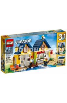Конструктор LEGO Криэйтор. Домик на пляже (31035)Конструкторы из пластмассы и мягкого пластика<br>Конструкция домика состоит из двух частей, соединённых между собой. <br>Стены выполнены из солнечно-жёлтых деталей, а крыши - из тёмно-синих. <br>Перед фасадом располагается песчаный пляж и деревянный пирс для подхода к воде.<br>При желании на пляже можно поставить столик с напитками и шезлонг<br>На стенах дома предусмотрены крепления для фонаря, весла и досок для сёрфинга. <br>Внутреннее пространство дома разделено на две комнаты, каждая которых имеет свой вход и свой интерьер.<br>В набор входят 2 минифигурки и множество аксессуаров:<br>доски для серфинга<br>мебель<br>ведро<br>чашка и другое.<br>Можно собрать 3 разных домика.<br>Количество деталей: 286 шт.<br>Материал: пластмасса.<br>Не рекомендовано детям младше 3-х лет. Содержит мелкие детали.<br>Детям от 7 до 12 лет.<br>Сделано в Дании.<br>