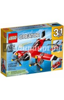 Конструктор Creator. Путешествие по воздуху (31047)Конструкторы из пластмассы и мягкого пластика<br>Конструктор Lego Creator Путешествие по воздуху непременно порадует каждого ребенка!<br>Испытай этот классический самолёт, раскрашенный в красный, белый и черный цвета и оснащённый вращающимися винтами и открывающейся кабиной с местом для минифигурки (не входит в комплект). Прыгай в кабину, оставь взлётную полосу внизу и взлетай под облака. А когда полёт закончится, выпускай шасси, чтобы совершить идеальную посадку! Перестрой модель в высокотехнологичный гидроплан или вертолёт.<br>Детали конструктора выполнены из высококачественного пластика и совершенно безопасны для ребенка.<br>Количество деталей: 230 шт.<br>Материал: пластмасса.<br>Не рекомендовано детям младше 3-х лет. Содержит мелкие детали.<br>Детям от 7 до 12 лет.<br>Сделано в Дании.<br>
