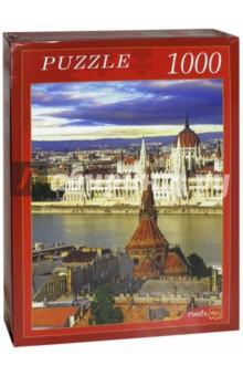 Puzzle-1000. Здание парламента в Будапеште (КБ1000-6894)Пазлы (1000 элементов)<br>Пазлы - популярная занимательная игра, которая развивает мелкую моторику рук, память, внимание посредством собирания яркой и красочной картинки, состоящей из мелких деталей. <br>Серия 1000 элементов - это огромное разнообразие дизайнов - города и страны, животные и птицы, искусство и живопись и многое-многое другое. <br>Количество элементов: 1000.<br>Размеры собранной картинки: 68,5x48,5 см.<br>Материал: картон.<br>Упаковка: картонная коробка.<br>Сделано в России.<br>