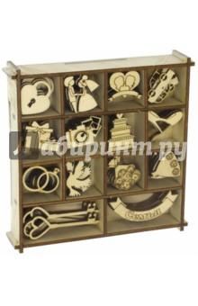 Набор украшений в коробке Свадебный №2Скрапбук<br>Набор деревянных украшений в коробке Свадебный №2.<br>14 видов  украшений в одной коробочке, по 6 штук каждого вида.<br>Коробка: 13,5х13,5 см.<br>Размер изделия: 2,5-3 см.<br>