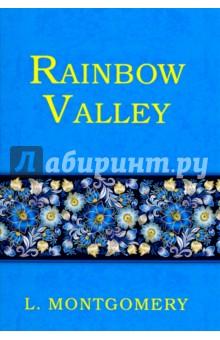 Rainbow ValleyХудожественная литература на англ. языке<br>Радужная долина - очередной бестселлер известной канадской писательницы Люси Монтгомери, продолжающий увлекательное повествование о судьбе девочки-сироты. Анна - счастливая жена и мать шестерых детей, живёт с мужем в любимом Инглсайде. Но в их размеренную жизнь вмешивается новый сосед-вдовец, священник Джон Мередит, и его дети. Смогут ли они найти общий язык и стать хорошими друзьями, или это начало вражды, которая приведёт к катастрофическим последствиям? Читайте зарубежную литературу в оригинале!<br>